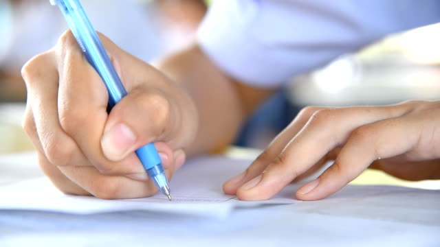 close up a hands of student during the exam in the classroom video
