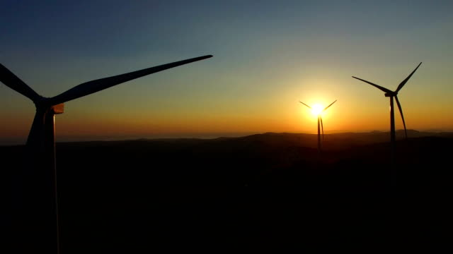 Close up aerial view of windmill blades at sunset video