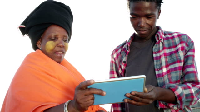 Close up African woman discusses over digital tablet with young man video