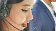 close up asian Call centre agents working office video