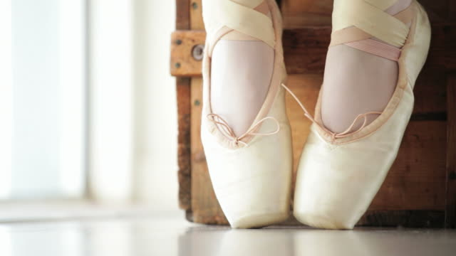 Close up Ballerina's feet stretching video