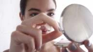 Close up, beautiful woman applying face powder   GL LI video