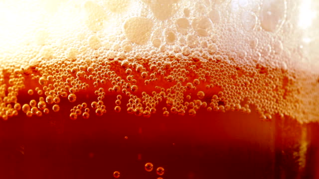 Close up beer glass with bubbles video