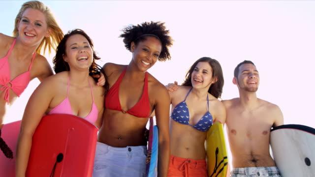 Close Up Blonde Teenager Friends Beach Background video