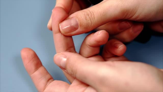 Close up blood sampling for glucometer on test strip. Female hand. video