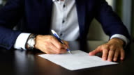 Close up business man signing contract making a deal, classic business video
