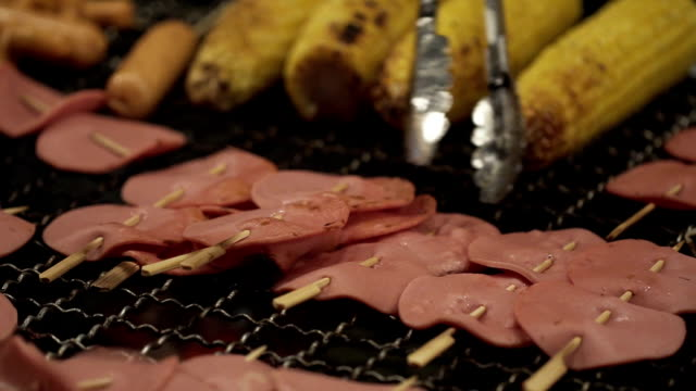 Close up chef cook Grilling  Sliced ham and Delicious Sweet Corn video