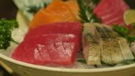 close up chopstick pick up tuna sashimi video