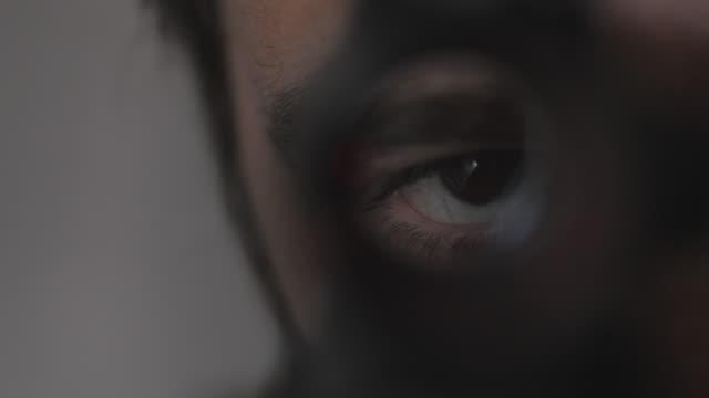 Close Up Cinematic Man Looks Through Gun Scope video