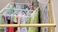 Close up. clothes dryer and plastic clips. drying equipment. video