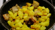 Close up. Cooking potatoes in a pan. Fragrant fried potatoes video