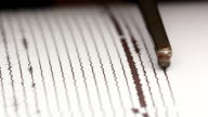 close up drum recorder recording seismic signal video