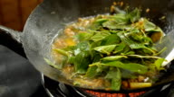 close up : fill Thai basil leaves into food video