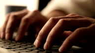 Close up footage of male hands typing on laptop keybord video