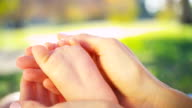Close up Gentle Hands Cradling Baby Foot video