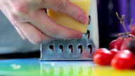 Close up grating cheddar cheese video