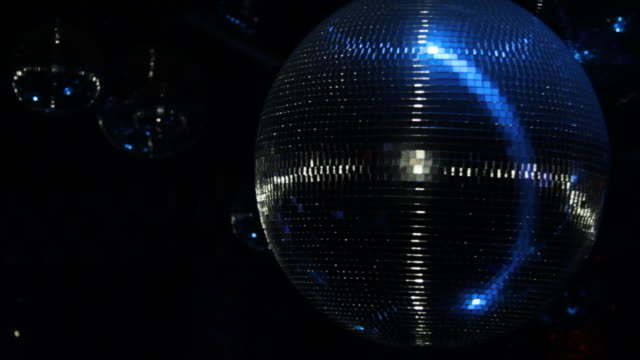Close Up Group Of Disco Ball And Laser Light video