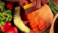 Close up hand of Woman slicing carrots video