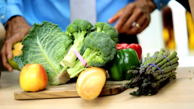 Close Up Hands African American Couple Kitchen Fresh Vegetables video