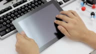 Close up hands man using tablet computer video