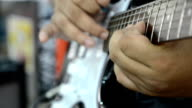 Close up hands playing electric guitar solo with speed picking technic video