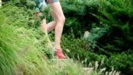 HD: Close up heels of woman walking over a bridge video