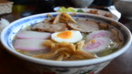 Close up hot Ramen steam with sliced streaky pork video