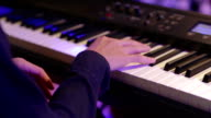 Close up human hand playing piano at concert party video