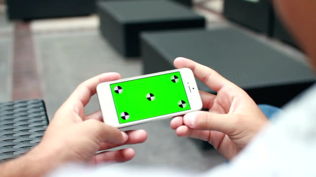 Close Up Man Hand Holding Phone With Green Screen video