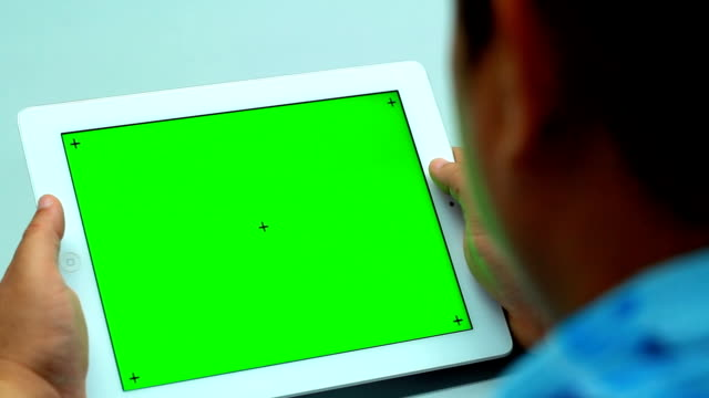 Close Up Man Holding Blank Tablet PC With Green video