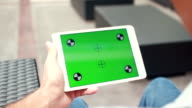 Close Up Man Using Touch Screen Tablet With Green Screen video