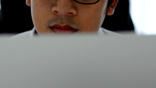 Close up man working with computer in office video