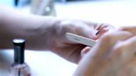 Close up nail polish a nail file video