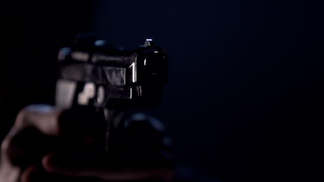 Close up of 9 mm handgun. Shooter takes three shots video