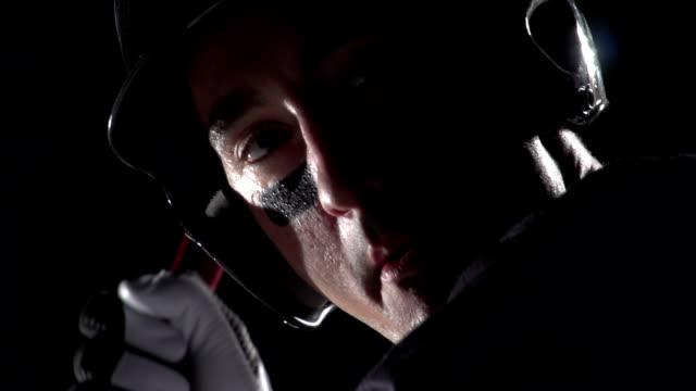 Close up of a baseball players face as he bats video