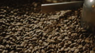 Close up of a coffee roaster cooling tray 4K video