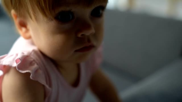 Close up of a cute toddler resting on the sofa video