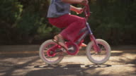Close up of a girl riding a bicycle video