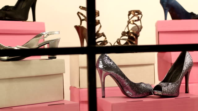 Close up of a Shoe shop window display - DOLLY video