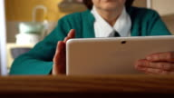 Close up of a tablet PC in a mature woman hands video