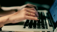 Close up of a woman hands working with a laptop at home video