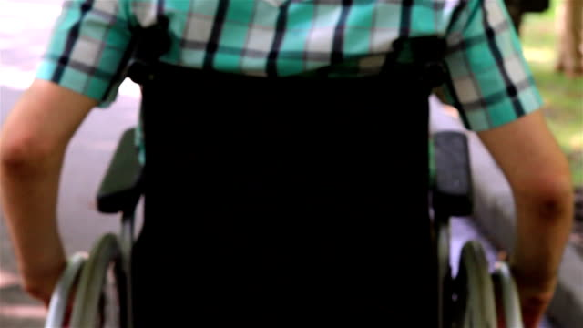 Close up of a young man in a wheelchair video