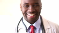 Close up of African American doctor smiling video