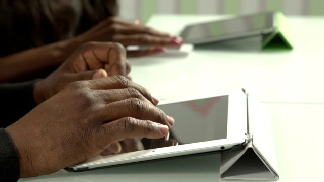 Close up of African American hands using technology video