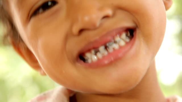 Close up of asian child caries video
