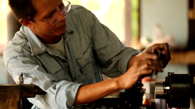 Close up of asian worker with machine in workshop video