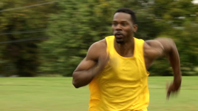 Close Up of Athletic Man Running Past the Camera video