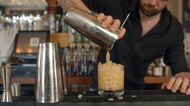 Close Up Of Barman Pouring Cocktail Into Glass video