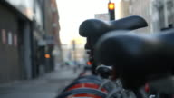 Close Up Of Bicycle Saddles In Urban Setting video