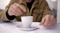 Close up of bold middage man drinking hot coffe, smoking cigarrete, enjoying outdoors in caffee video
